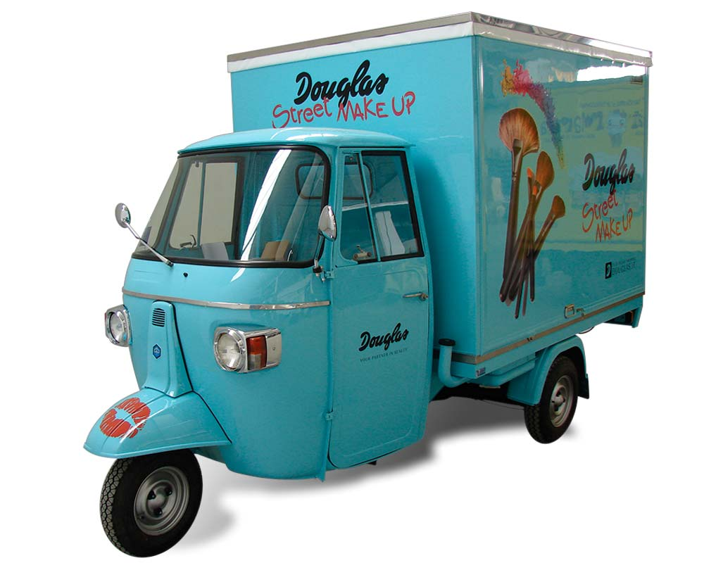 promotional truck piaggio for the company douglas make-up