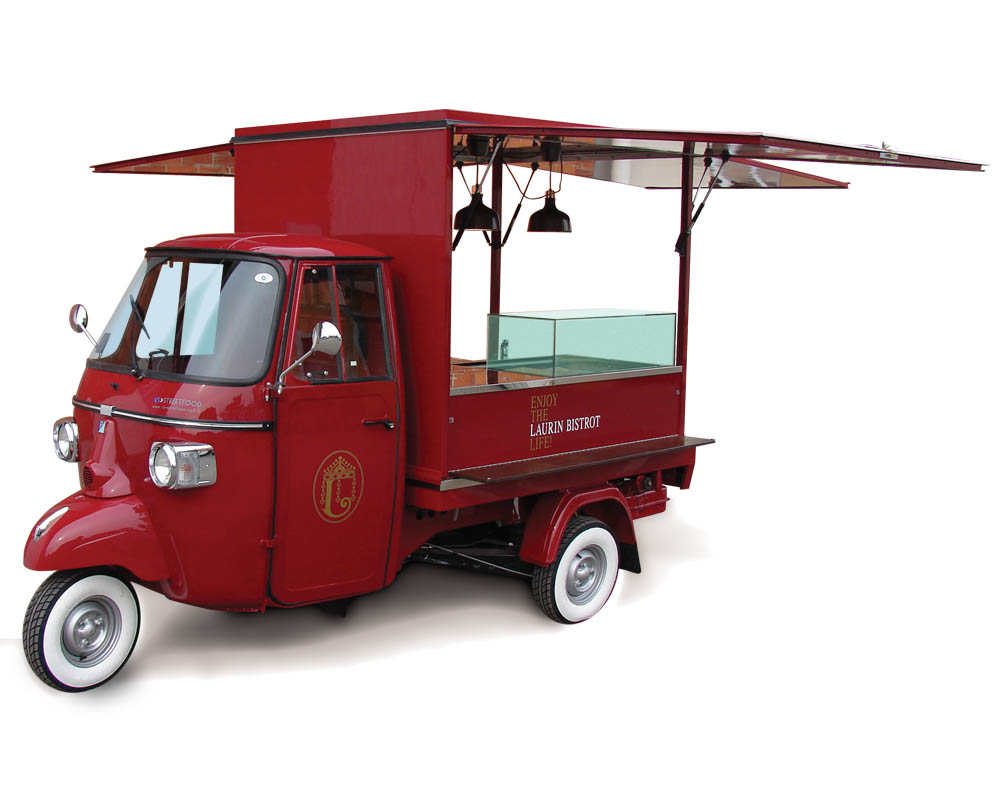 Laurin Hotel Bistrot on Piaggio Ape Car selling drinks and cocktails