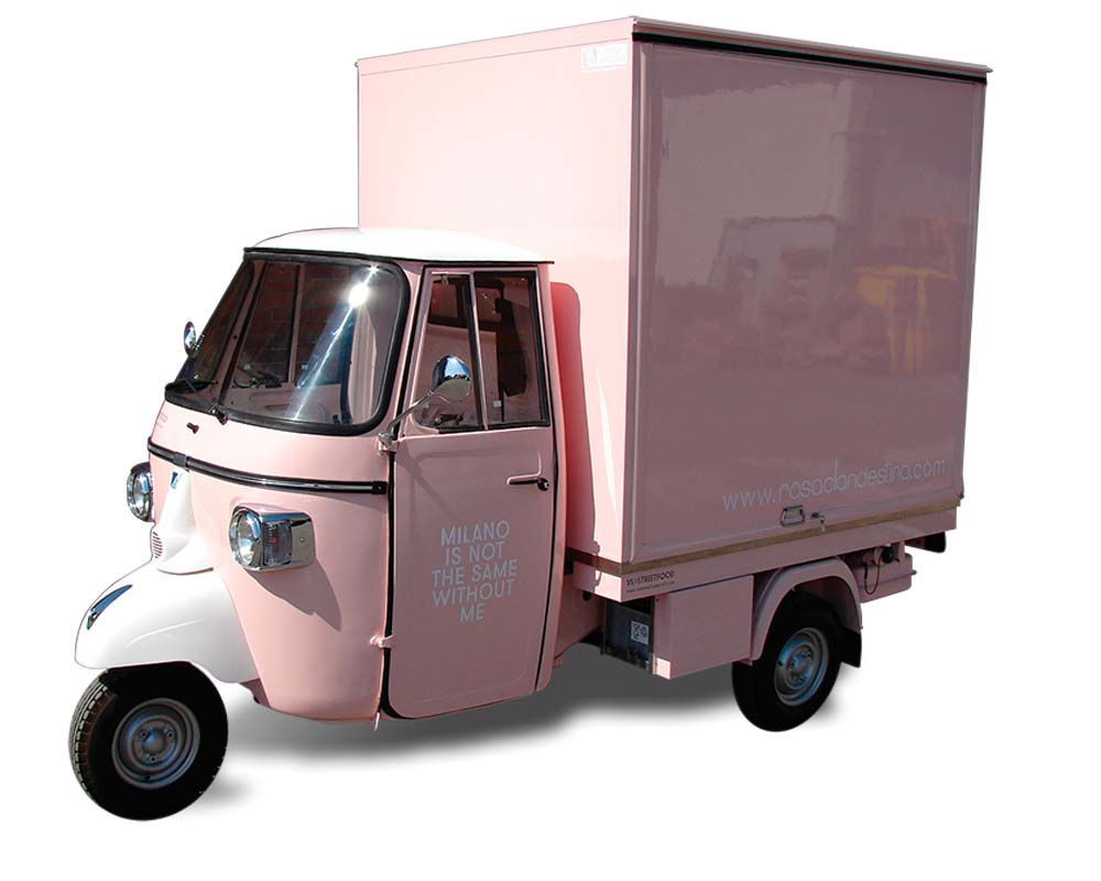 piaggio ape shop for fashion brand Rosa Clandestino in pink colour