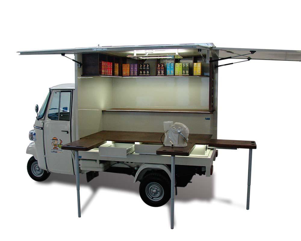 piaggio ape café annonçant des véhicules en capsules pour promouvoir les machines à café Dorhouse