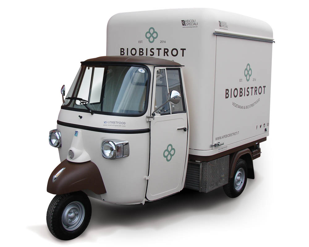 Piaggio Ape for street food of vegan delicacies in Trento. Colour white and brown