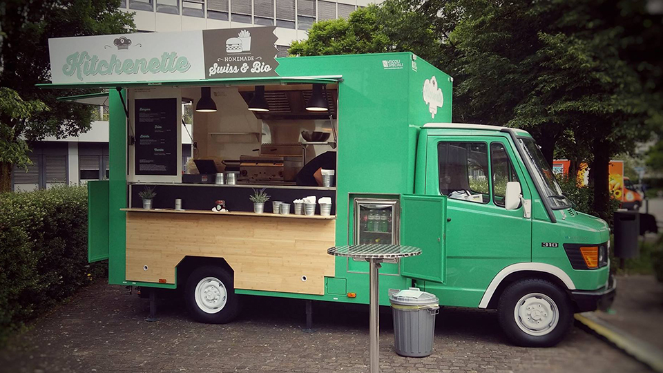 Food Truck Mercedes 310 designed for vending hamburgers and french fries. Green colour