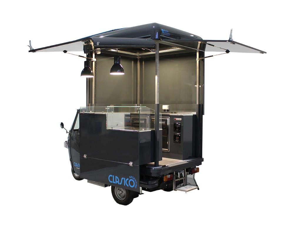Ape per lo street food di Clasico Argentino a Londra. Vista interno con frigo e 2 forni elettrici