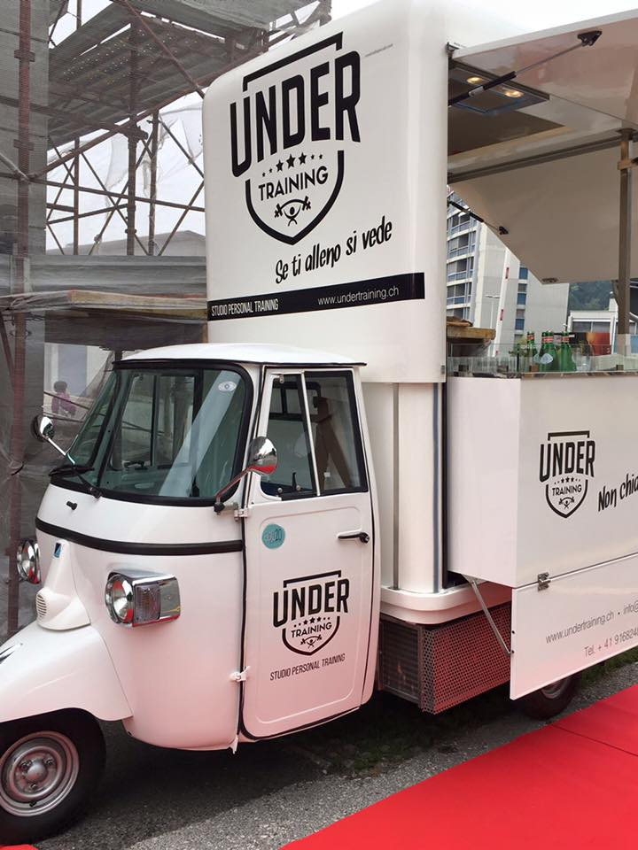 under training promotional piaggio ape equipped for bar service