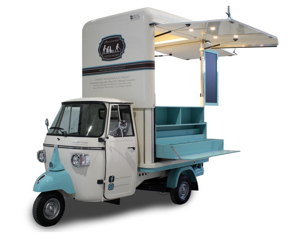 negozio mobile e promo truck di officina cosmetica. Colore celeste e panna con cassetti espositivi