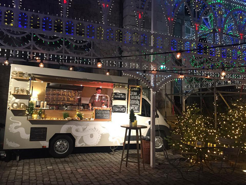 sanfish food truck peugeot boxer at christmas market in wien