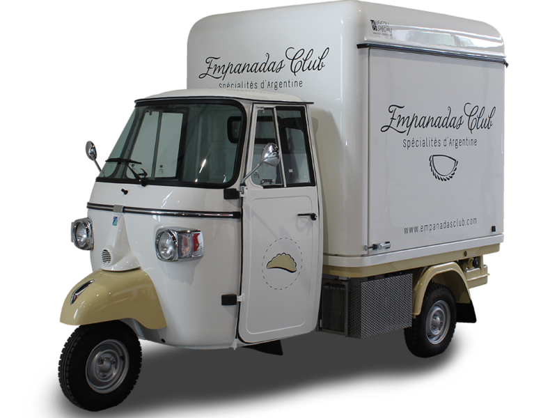 mobile kitchen outfitted on retro-style vcurved piaggio apecar designed for selling empanadas and more traditional argentine dishes