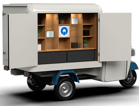 Piaggio ape shop with electric motor and retail set up for retail sales and product display