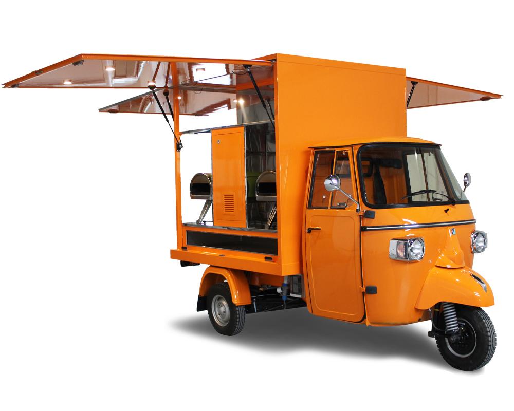 Dalla bicicletta al 3 ruote Piaggio Ape Pizza il passo è breve. Pizzavelo arancione comprato a costi economici da imprenditrice di Tolosa in Francia